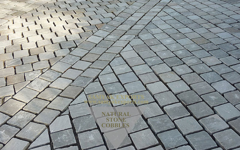 Budhpura Grey Sandstone Cobbles, Pebbles, Tumble Paving Stone Manufacturer in India